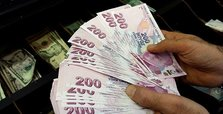 Turkish lira hits 2-month high, stocks up at close