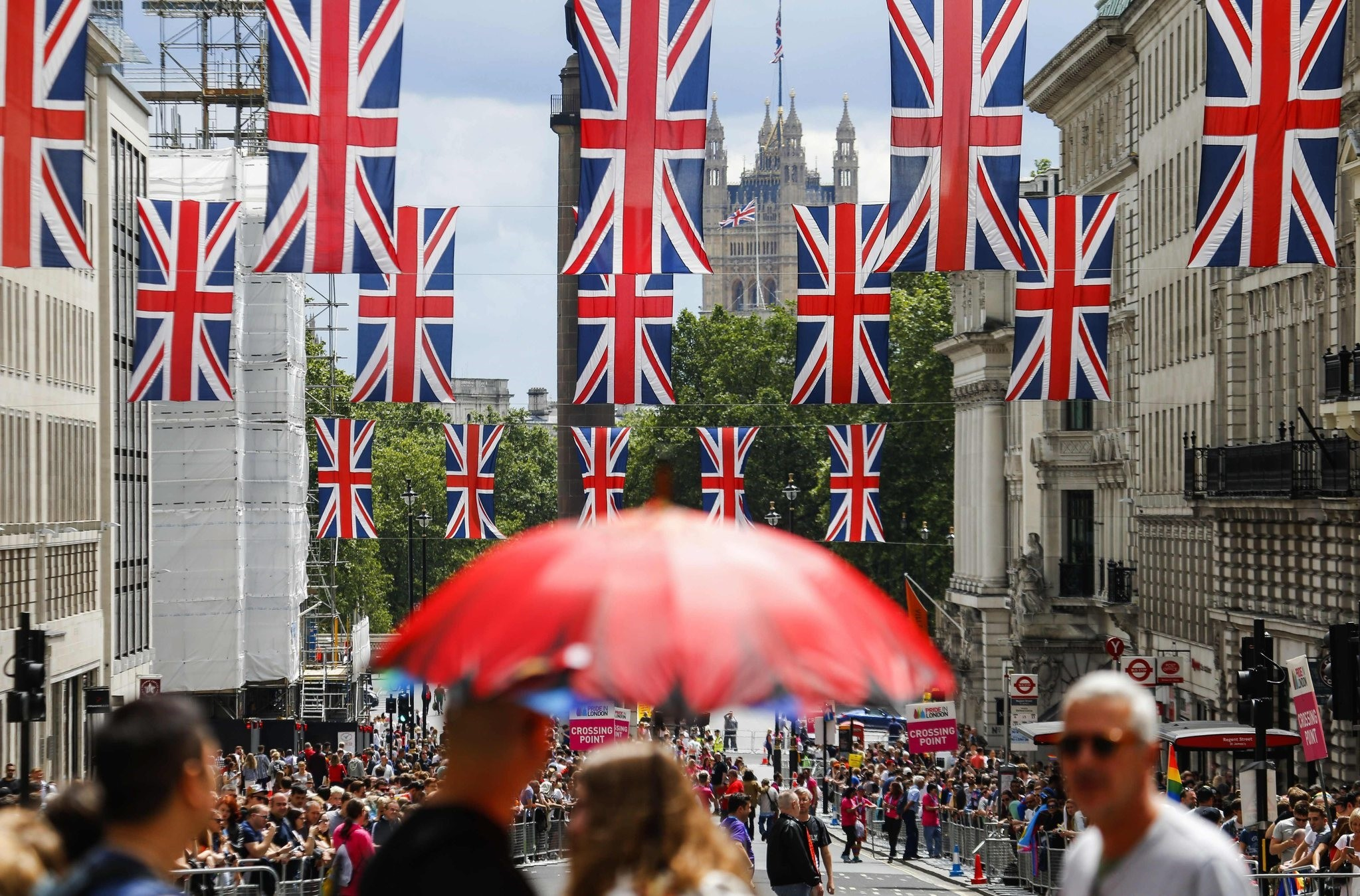 British flag banners hang across a street near the houses of Parliament in Central London after the announcement of results of shocking Brexit vote, June 25, 2016. (AFP Photo)