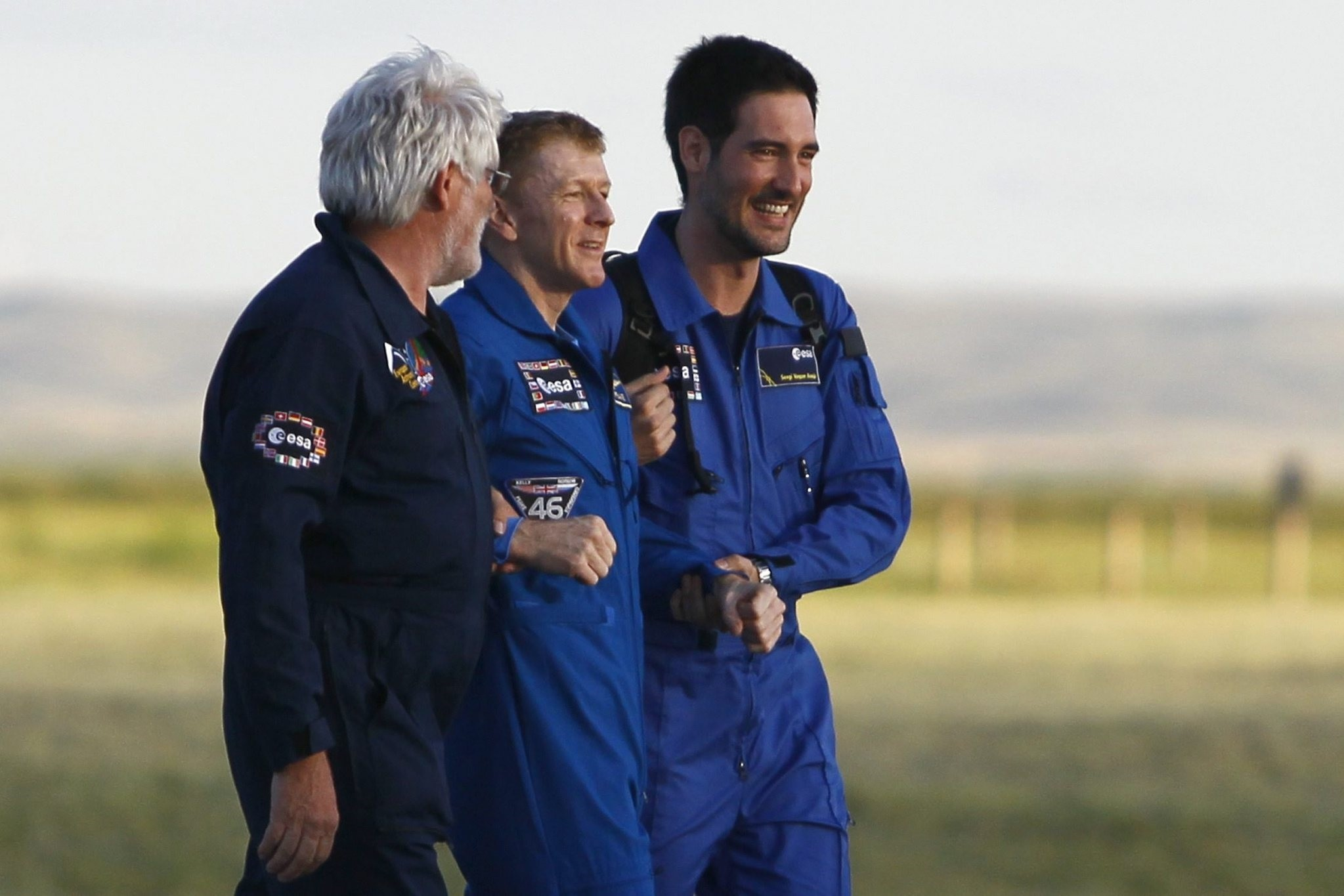 International Space Station (ISS) crew member Timothy Peake (C) of Britain is assisted by ground personnel upon his arrival at the airport of Karaganda, Kazakhstan, 18 June 2016. (EPA Photo)