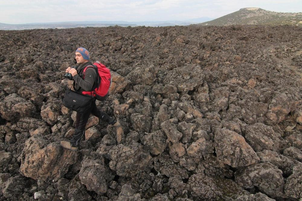 Kulau2019s landscape, formed by centuries of volcanic activity, is home to the first lava tunnel in Turkey. There are footprints believed to belong to ancient civilizations here. (Photo courtesy of Kula Volcanic Geo-park)