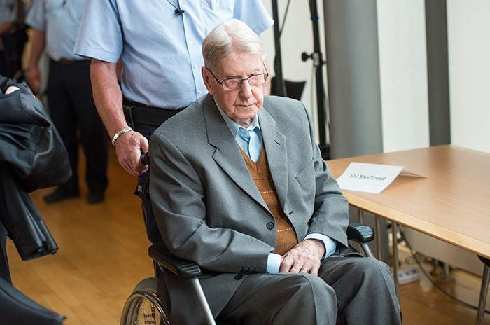 In this Saturday June 11, 2016 file photo, 94-year-old former SS guard at the Auschwitz death camp Reinhold Hanning, arrives at a courtroom in Detmold, Germany. (AP Photo)