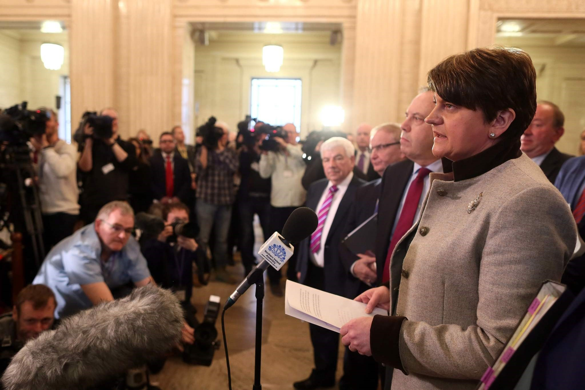 Democratic Unionist Party leader Arlene Foster, speaks to members of the media in the Great Hall at Stormont before the start of the Assembly in Belfast, Northern Ireland. (AFP Photo)