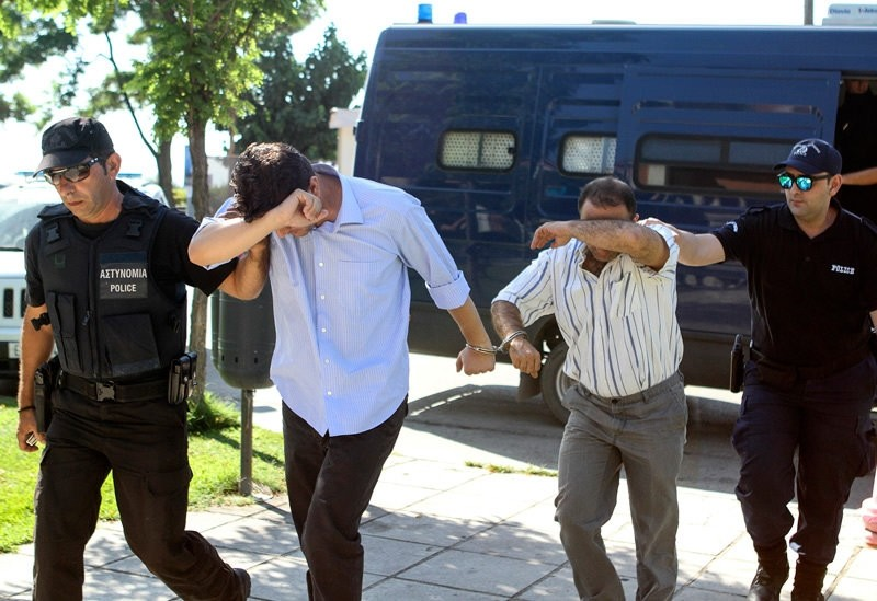 Two of eight Turkish soldiers who fled to Greece in helicopter and requested political asylum after a failed military coup, are brought to prosecutor in Alexandroupolis, Greece July 17, 2016.  REUTERS Photo