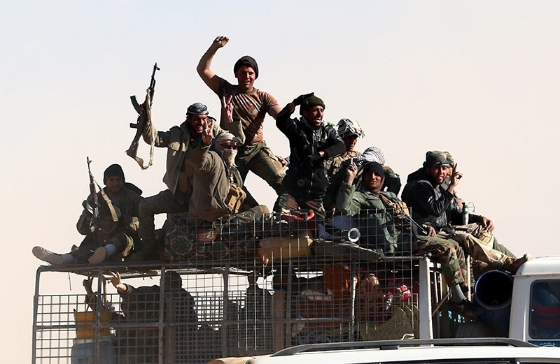 Members of Iraqi Shiite Badr Army militia on their way to take part in a military operation near Tal Afar military airport, northern Iraq on Nov. 20, 2016. (EPA Photo)