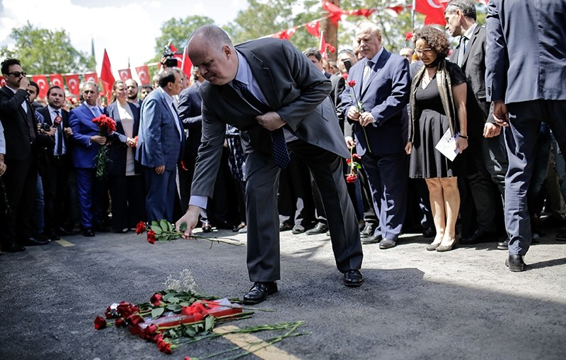 Consuls of European countries leave cloves on June 8, 2016 on the site of yesterday's bomb attack that killed 11 people including several police officers, in the Vezneciler district of Istanbul.