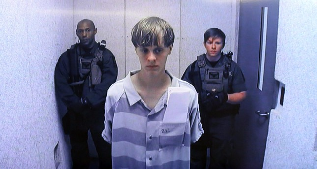 A file picture dated 19 June 2015 shows suspect Dylann Roof (C) appearing via video link at a bond hearing in court in North Charleston. (EPA Photo)