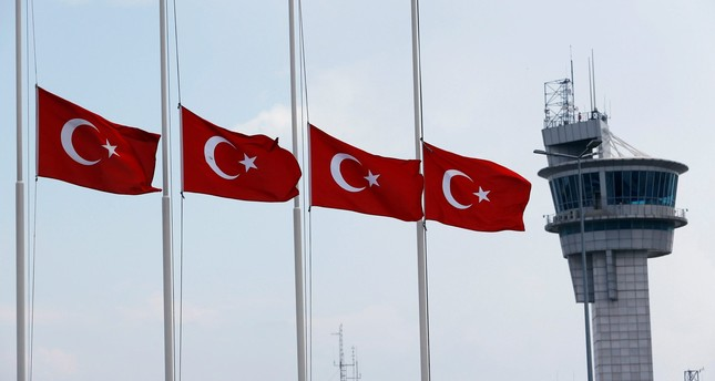 Turkish flags, with the control tower in the background, fly at half mast at the country's largest airport, Istanbul Atatürk, following the June attack there. (Reuters Photo)