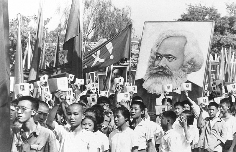 In this Sept. 14, 1966 file photo, youths are seen at a rally during the height of the Red Guard upheaval carrying a poster of Karl Marx (AP Photo, File)