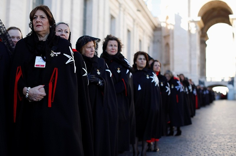 Members of the Order of the Knights of Malta arrive in St. Peter Basilica for their 900th anniversary at the Vatican February 9, 2013. (Reuters Photo)