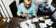 Turkish craftsman forges unique silver, gold facemasks