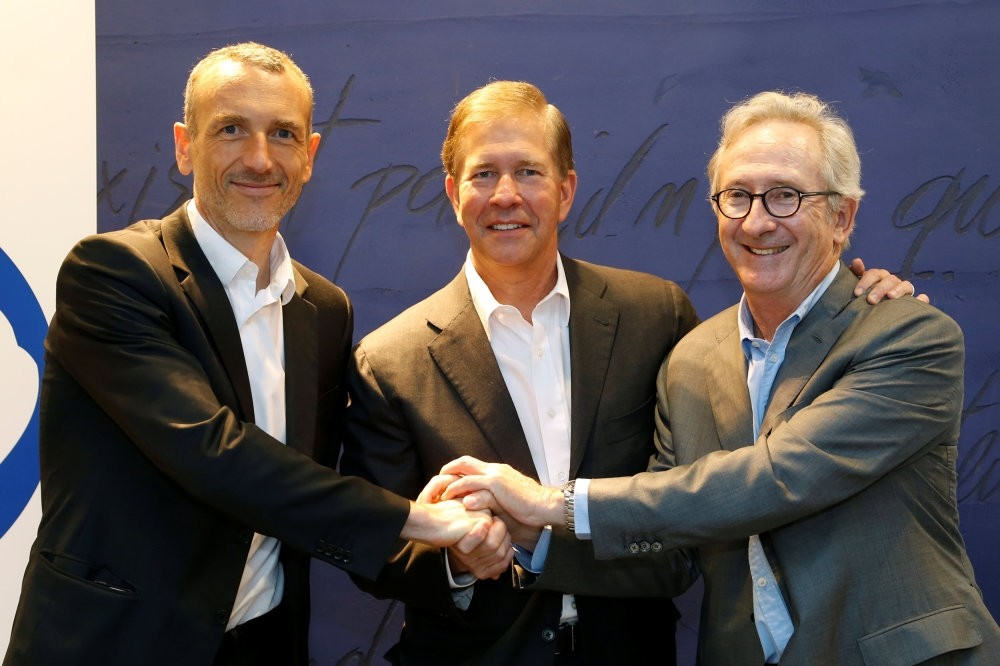 From L-R, Emmanuel Faber, CEO of Danone, Gregg Engles, CEO of WhiteWave Foods Company, and Franck Riboud, Chairman of French food group Danone, pose before the start of a news conference in Paris. (Reuters Photo)