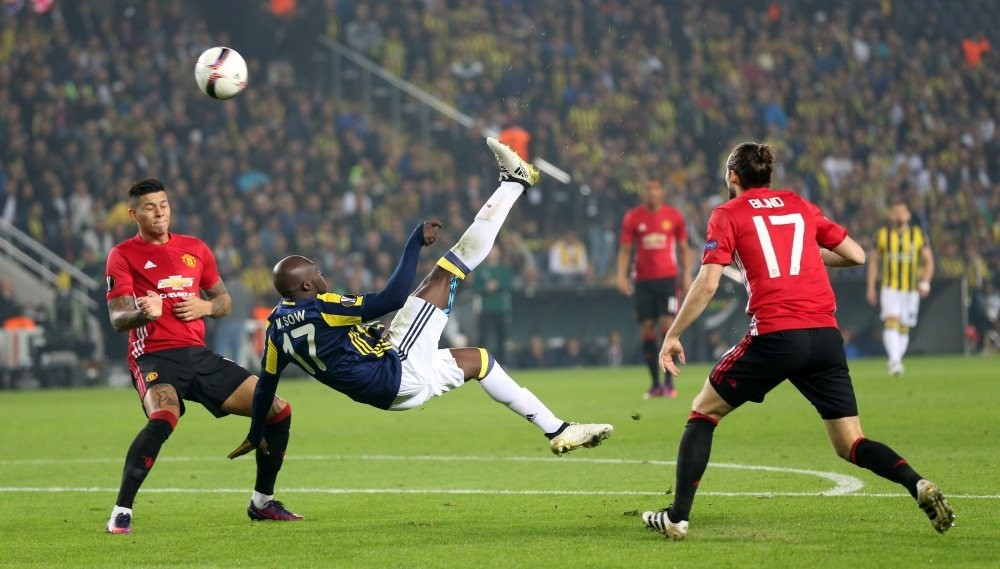 Moussa Sow (C) scores the 1-0 under defense of Manchester Unitedu2019s Marcos Rojo (L) and Daley Blind at the UEFA Europa League group A match.