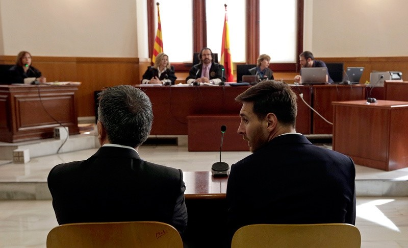 Barcelona's Lionel Messi, right, and his father Jorge Horacio Messi sit in court in Barcelona, Spain, Thursday June 2, 2016.   AP Photo
