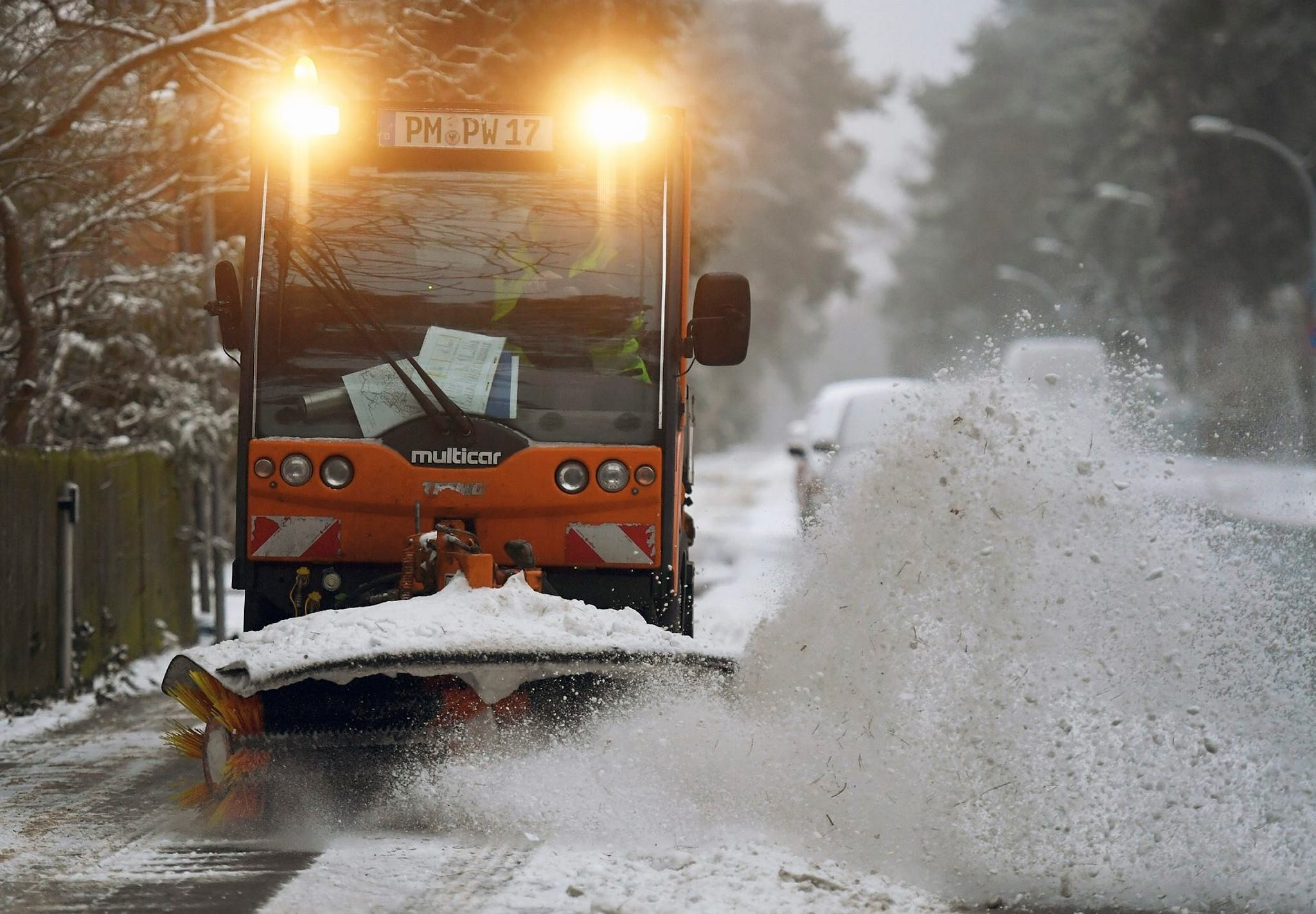 A street is cleared from snow in Kleinmachnow, eastern Germany, Sunday Jan. 8.