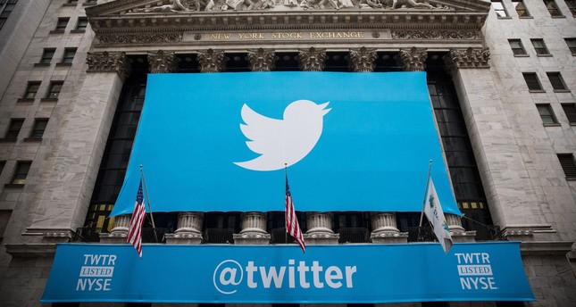 This file photo taken on November 6, 2013 shows the Twitter logo displayed on a banner outside the New York Stock Exchange (NYSE) in New York. (AFP Photo)