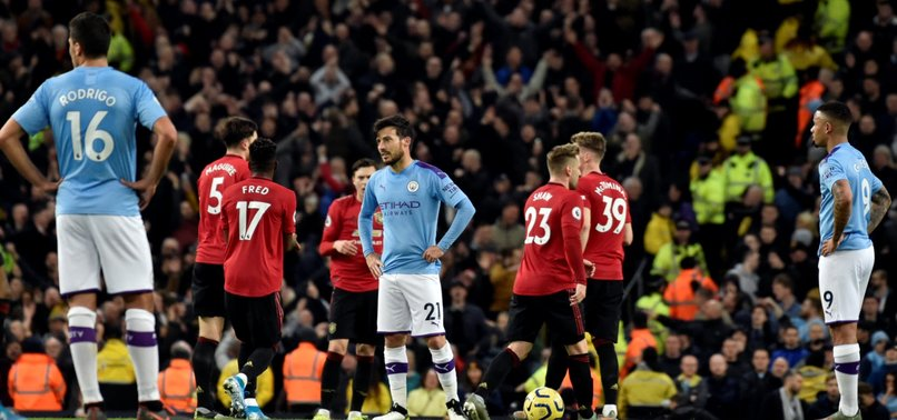 MANCHESTER CITY TITLE HOPES IN TATTERS AFTER DERBY LOSS TO RED DEVILS