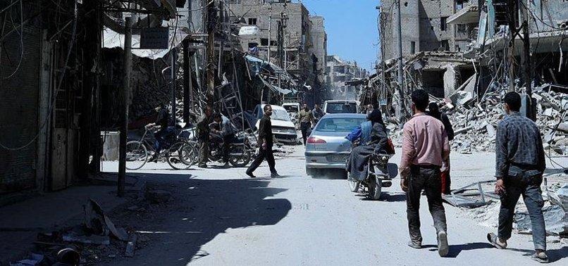 DESTRUCTION, TRAUMATIZED RESIDENTS IN SYRIAN TOWN OF DOUMA