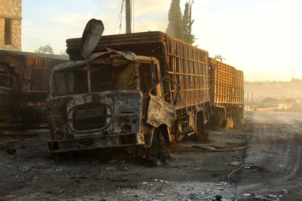 Damaged aid trucks hit by a deadly airstrike in the moderate-held town of al-Kubra, western Aleppo city of Syria, Sept. 20, 2016.