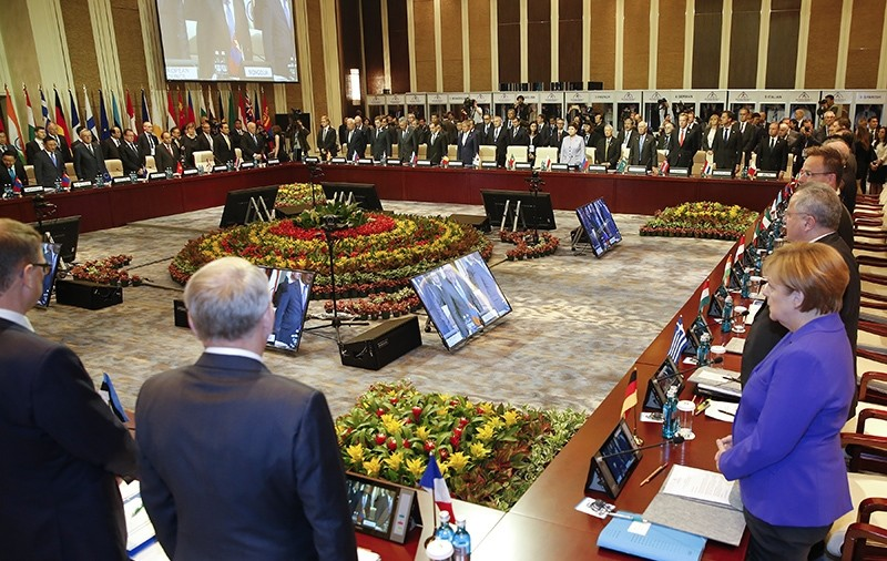 Leaders stand for a minute of silence for the victims of a deadly attack in the French city of Nice, before the opening session of the Asia-Europe Meeting (ASEM) summit in Ulaanbaatar, Mongolia (AP Photo)