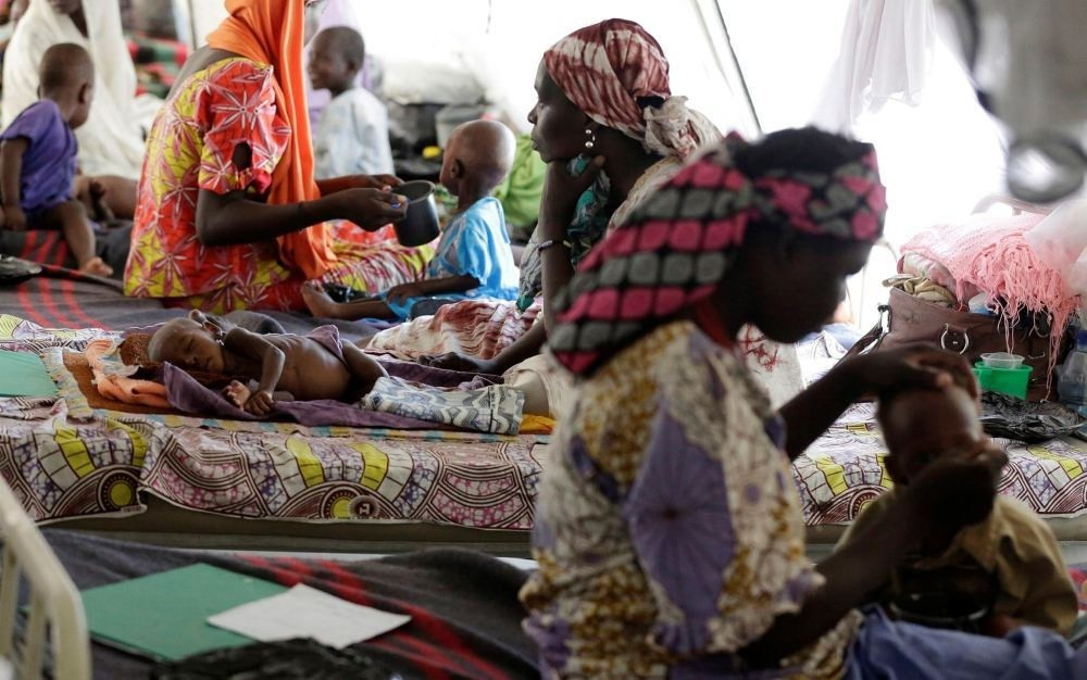 Nigerian women feed their malnourished children at a feeding center run by Doctors Without Borders in Maiduguri, Nigeria on Aug. 29.
