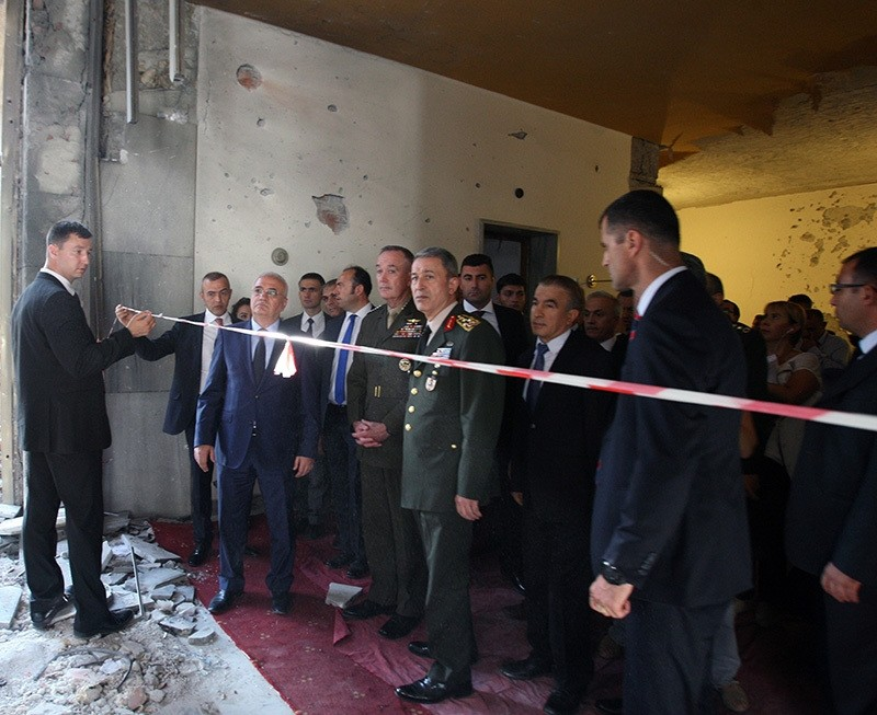 US Chief of Staff Dunford (left in uniform), accompanied by Turkish Chef of Staff Hulusi Akar (right in uniform) inspects the damage at Turkey's Parliament in Ankara on August 1. (IHA Photo)