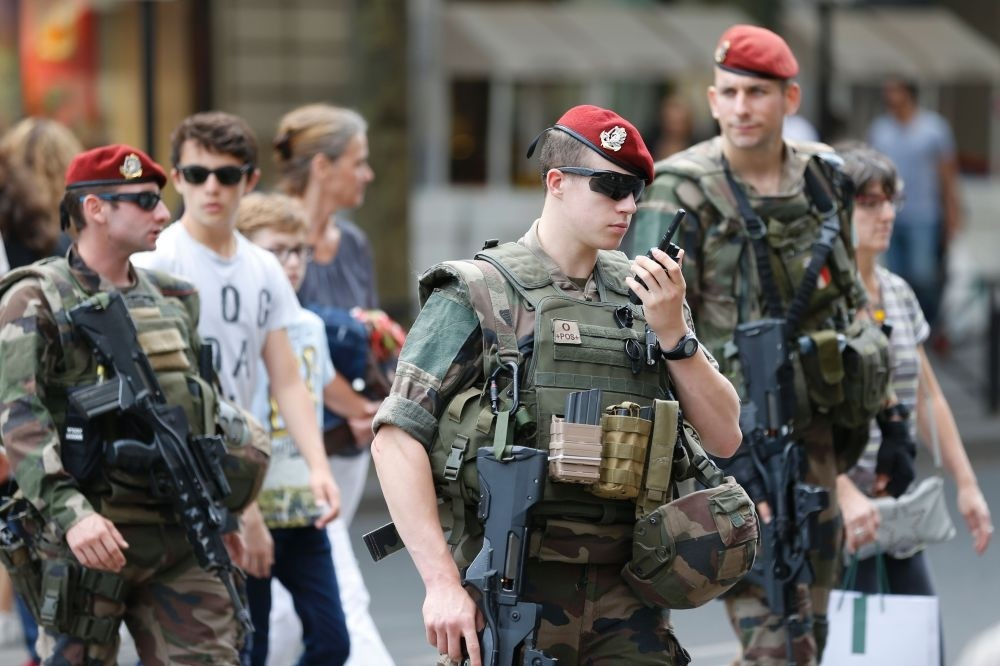French soldiers patrol near the Galeries Lafayette in Paris on July 15.