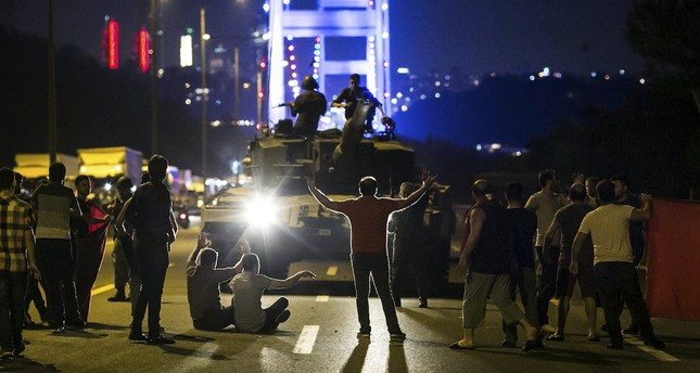 People take over a tank near the Fatih Sultan Mehmet bridge during clashes with military forces in Istanbul on July 16, 2016.  (AFP Photo)