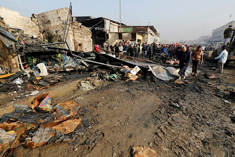 People gather at the site of a car bomb attack at a vegetable market in eastern Baghdad, Iraq January 8, 2017 (Reuters Photo)