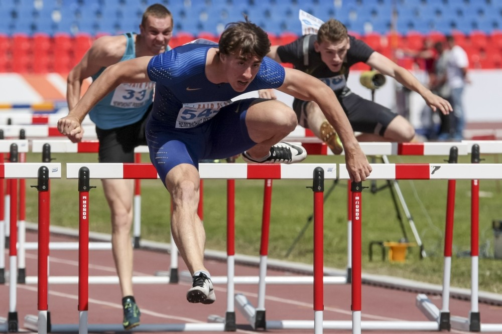 World 110-meter champion Sergei Shubenkov competes at the National track and field championships at a stadium in Cheboksary.