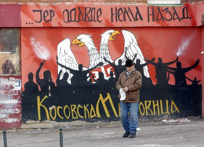 A Serb resident of the northern part of Kosovska Mitrovica passes by a graffiti reading 'From here there is no way back' in the northern part of Kosovska Mitrovica, Kosovo on Jan. 15, 2017. (EPA Photo)