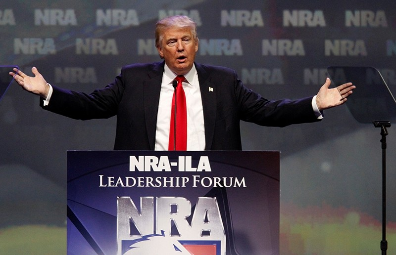 Republican presidential candidate Donald Trump addresses members of the National Rifle Association during their NRA-ILA Leadership Forum