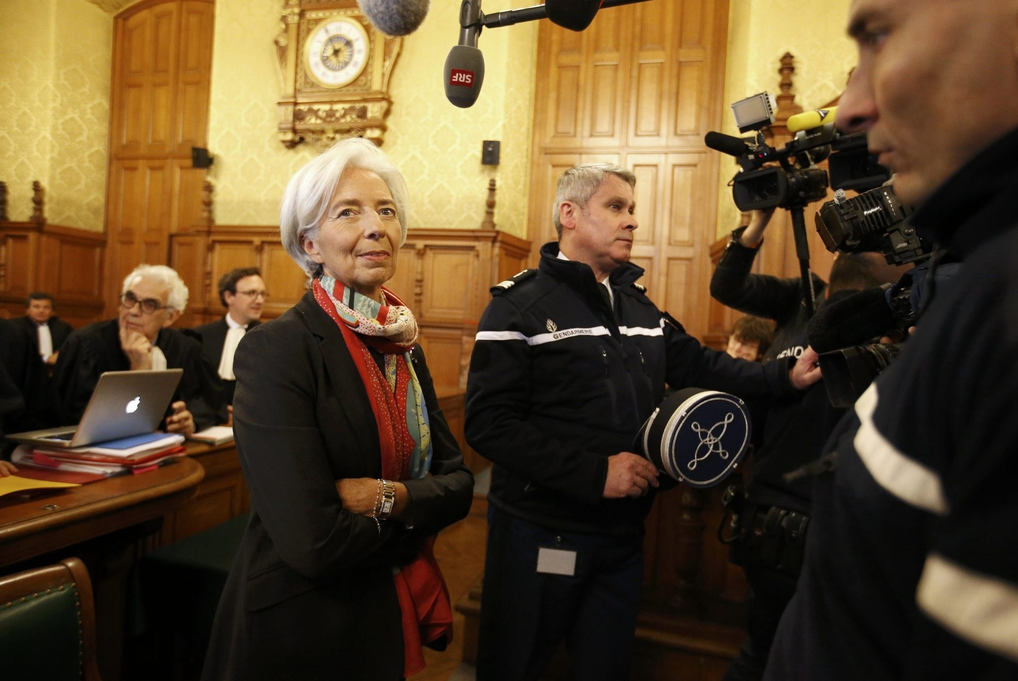 Lagarde (L) reacts before the start of her trial about a state payout in 2008 to a French businessman, at the courts in Paris. (REUTERS PHOTO)