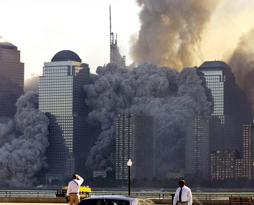 The remaining tower of New York's World Trade Center dissolves in a cloud of dust and debris about a half hour after the first twin tower collapsed. (REUTERS Photo)