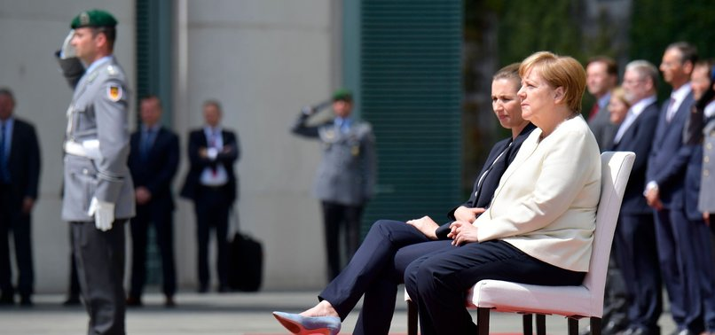 GERMANYS MERKEL SITS FOR ANTHEMS AFTER SHAKING EPISODES