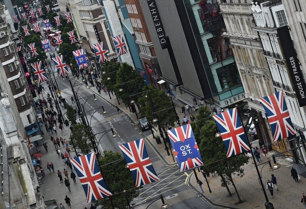 Union flags hang over Oxford Street in London on Wednesday as Britain's economy grew by 0.6 percent in the run up to the Brexit vote. Signals since the Brexit vote, however, indicate that the economy is slowing and could fall into recession.