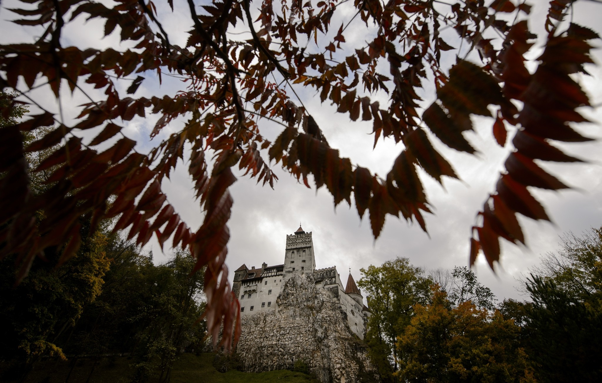 In this picture taken Oct. 9, 2016, Bran Castle lies on top of cliffs in Bran, Romania. (AP Photo)