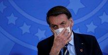 Brazil's Bolsonaro, sick with coronavirus, says 'doing very well'