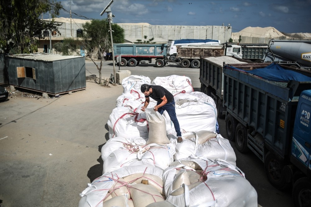 Trucks carrying aid gradually arrive in Gaza where a blockade restricted access to food and other vital goods.
