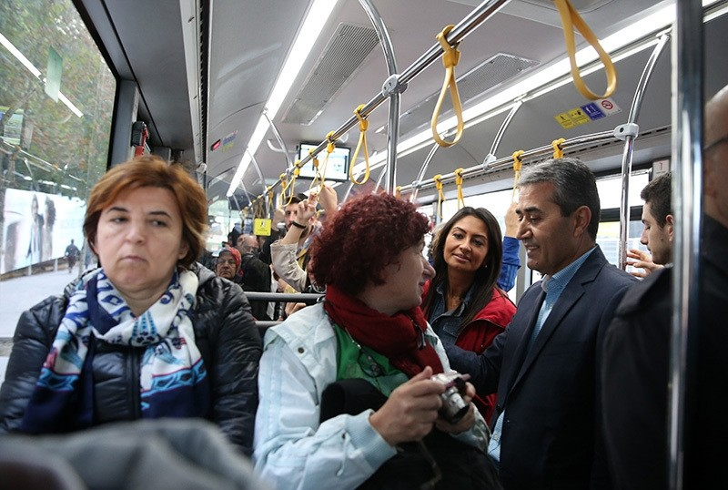 IETT General Manager Arif Emecen (R) talks with the passengers in a bus on Oct. 7 during the 'Empathy Week,' held since 2012 to increase quality of public transport. (AA Photo)