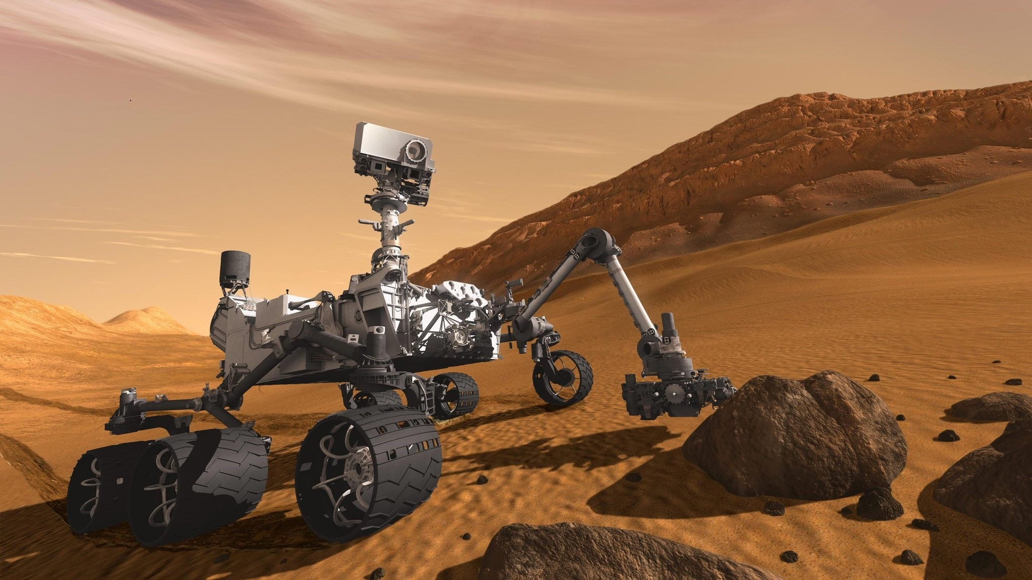 In this 2011 artist's rendering provided by NASA/JPL-Caltech, the Mars Science Laboratory Curiosity rover examines a rock on Mars with a set of tools at the end of its arm, which extends about 2 meters. (AP Photo)
