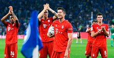 Lewandowski hat-trick steers Bayern past Schalke