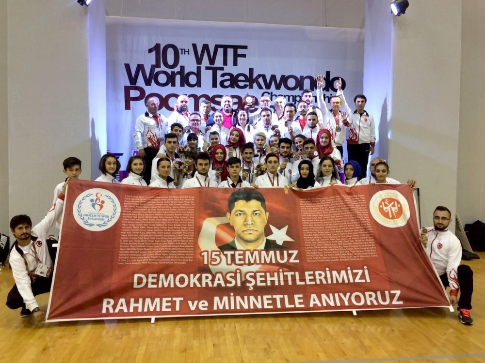 Turkey's world's second-ranked Taekwondo Poomse team commemorated the martyrs Turkey lost during the foiled coup attempt on July 15. The team poses with a banner of the late sergeant u00d6mer Halisdemir, who was killed by coup plotters in Ankara.