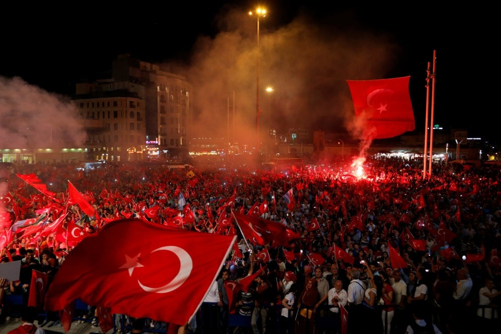 People waving Turkish flags during a demonstration against the failed coup attempt, Taksim Square, Istanbul, July 18.