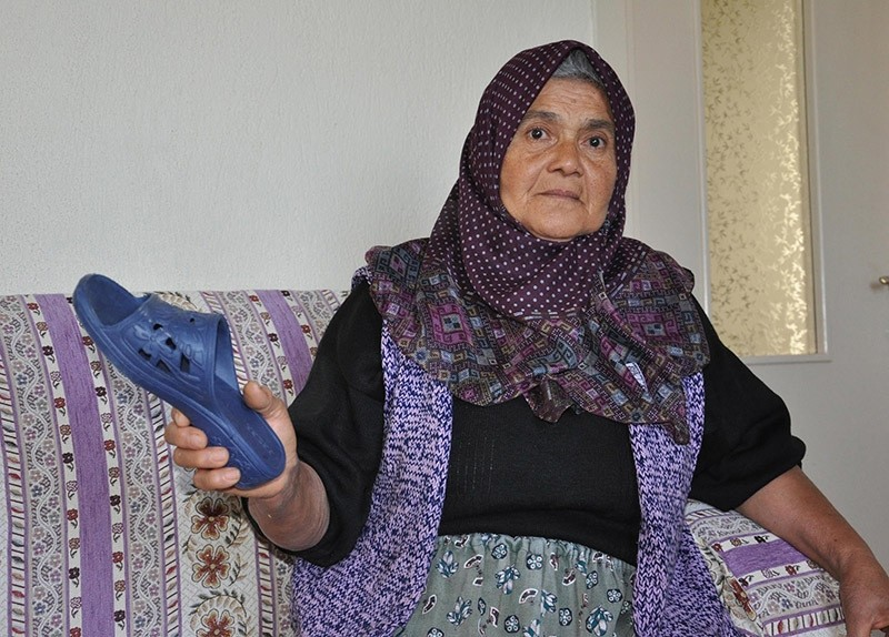 u015eenay Gu00fczel holding the slipper that was considered a weapon. (DHA Photo)
