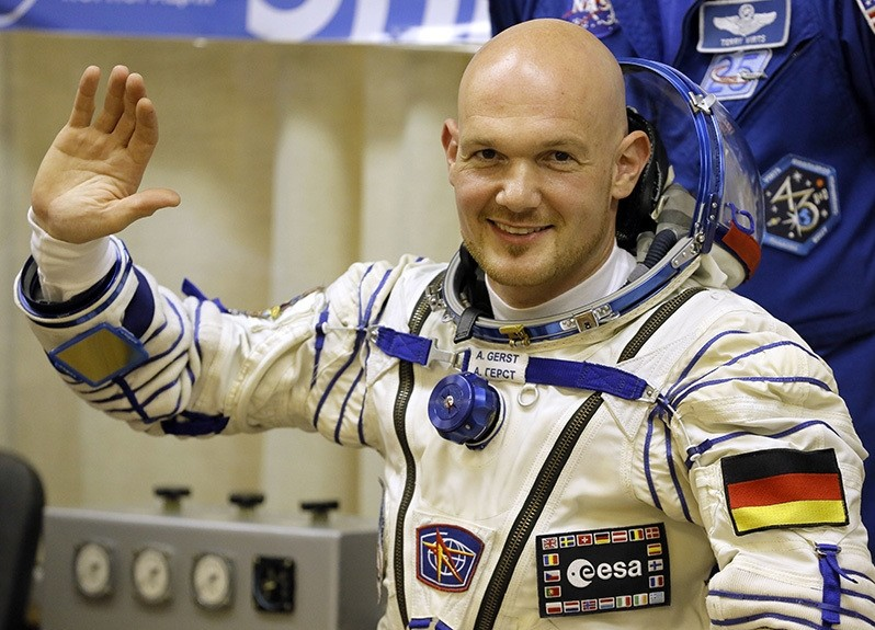 European Space Agency astronaut Alexander Gerst, crew member of the mission to the Int'l Space Station, waves during inspection of his space suit prior to the launch of the Soyuz-FG rocket at Baikonur cosmodrome, Kazakhstan, May 28, 2014. (AP Photo)
