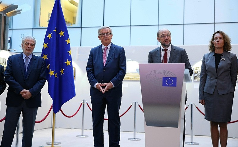 President of the European Parliament Martin Schulz (2nd R) speaks during the opening of a photo exhibition 'The missing lives of Cyprus' in Brussels, Belgium (AA Photo)
