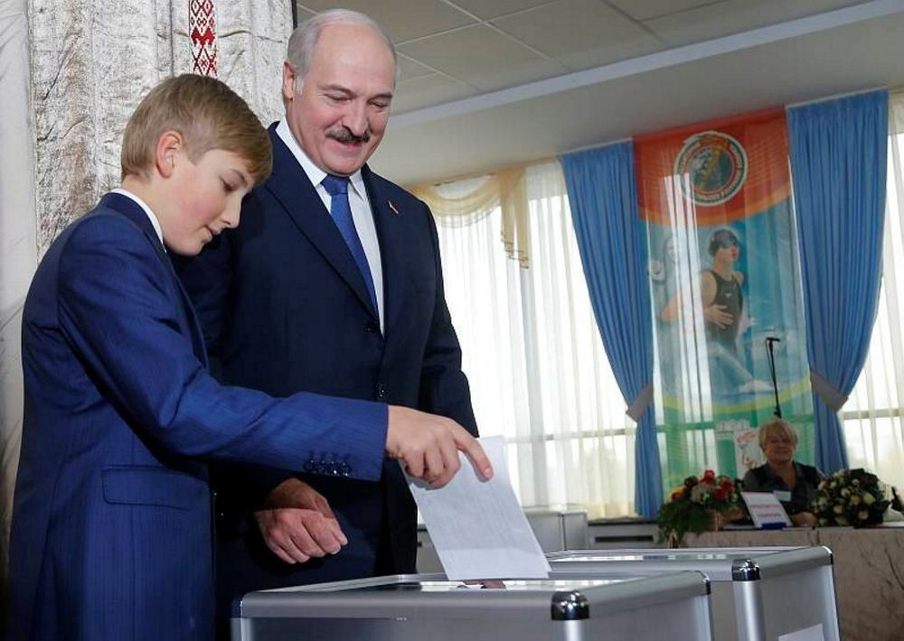 Belarusian President Alexander Lukashenko with his youngest son Nikolai casts his ballot at a polling station, during the presidential election, in Minsk, Belarus, Oct. 11, 2015.