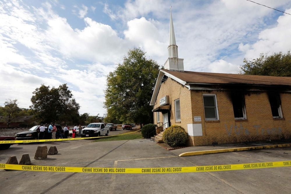 Authorities investigate the fire damaged Hopewell M.B. Baptist Church in Greenville, Mississippi,  Nov. 2.
