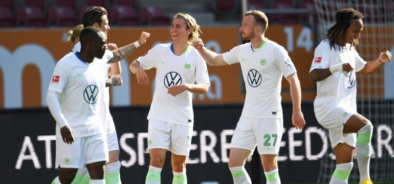 WOLFSBURG BEAT AUGSBURG 2-1 WITH GINCZEKS LATE WINNER