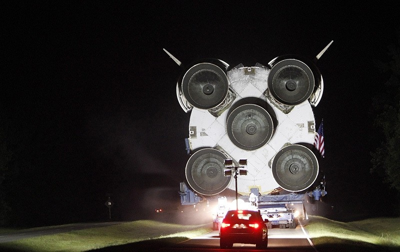 Crews guide a Saturn V rocket south on Highway 607 Monday night, June 20, 2016, near Pearlington, Miss. Eventually, the rocket made it to Infinity Science Center. (AP)